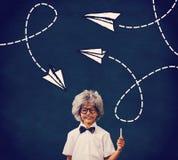 L'image composée de l'élève s'est habillée dans la perruque Photos stock