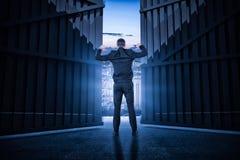L'image composée de l'homme d'affaires se tenant avec des mains lèvent 3d Photos stock