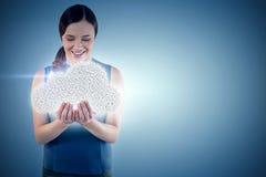 L'image composée de la belle femme heureuse avec des mains a mis en forme de tasse 3d Image stock