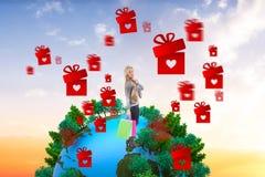 L'image composée de la blonde en hiver vêtx tenir des paniers Image stock