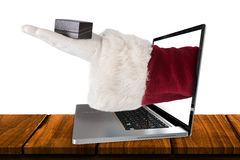 L'image composée de la main de Santa montre une petite case Photos stock