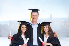 L'image composée de trois amis reçoivent un diplôme de l'université ensemble Images stock