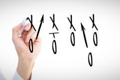 L'image composée des businessmans remettent l'écriture avec le marqueur Photo stock