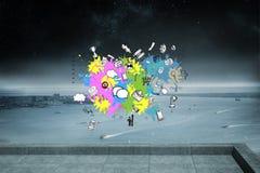 L'image composée des icônes de technologie et d'affaires sur la peinture éclabousse Image stock