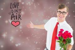 L'image composée du message d'amour et le ballot équipent tenir le groupe de roses Photographie stock libre de droits
