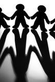 L'image noire et blanche de Silhoutted figure Joinin Photo libre de droits