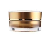 L'imballaggio del barattolo dell'oro isolato su fondo bianco Fotografia Stock