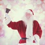 L'immagine composita del Babbo Natale suona la sua campana Fotografie Stock Libere da Diritti