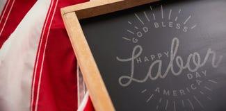 L'immagine composita dell'immagine composita della festa del lavoro felice ed il dio benedicono il testo dell'america Immagine Stock