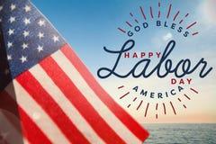 L'immagine composita dell'immagine composita della festa del lavoro felice ed il dio benedicono il testo dell'america fotografia stock libera da diritti