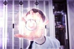 L'immagine composita dell'uomo d'affari con distribuisce Immagini Stock Libere da Diritti