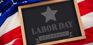 L'immagine composita della festa del lavoro celebra la bandiera americana di forma della stella e del testo Fotografia Stock Libera da Diritti