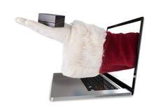 L'immagine composita della mano di Santa mostra una piccola scatola Fotografia Stock
