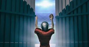 L'immagine composita della retrovisione del giocatore di football americano con le armi ha alzato 3d Immagine Stock Libera da Diritti