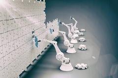 L'immagine composita della vista dell'angolo alto delle mani robot che sistemano il puzzle collega sul puzzle 3d Fotografia Stock Libera da Diritti