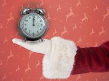 L'immagine composita delle manifestazioni del Babbo Natale apre la mano Fotografie Stock