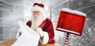 L'immagine composita di Santa scrive qualcosa con una piuma Fotografie Stock Libere da Diritti