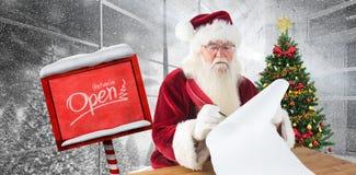 L'immagine composita di Santa scrive qualcosa con una piuma Immagini Stock