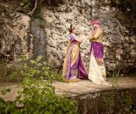 L'immagine d'annata delle coppie mature si è vestita in costume di balinese Fotografia Stock Libera da Diritti