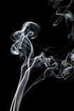 L'immagine di fumo su fondo nero Immagini Stock