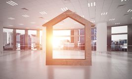L'immagine di sfondo concettuale di domestico concreto firma dentro l'interno moderno dell'ufficio Immagine Stock