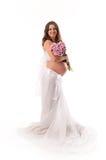 L'immagine di una donna incinta con i fiori viola. Fotografia Stock Libera da Diritti