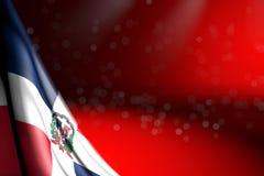 L'immagine graziosa della bandiera della Repubblica dominicana appende la diagonale su rosso con il fuoco selettivo ed il posto v illustrazione di stock