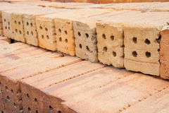 L'immeuble de brique rouge est important dans la construction des murs Photographie stock libre de droits