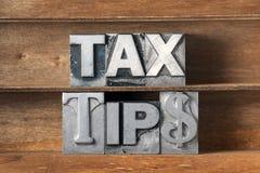 L'impôt incline le plateau photo stock