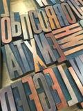 L'impression typographique de vintage en bois saisissent le plateau en bois Image libre de droits