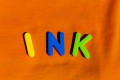 L'inchiostro di parola composto dalle lettere fotografia stock