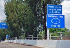 L'incrocio di strada del confine del controllo di Tuas fra Singapore e Johor, Malesia Fotografie Stock Libere da Diritti