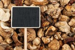 L'indicateur, le prix à payer se trouve sur des champignons Photographie stock