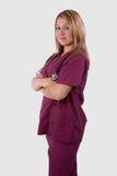 L'infirmière dans le rouge foncé frotte Photos stock