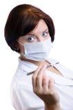 L'infirmière regarde le thermomètre Photo libre de droits