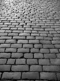L'Inghilterra: cobblestones sulla vecchia via Immagini Stock