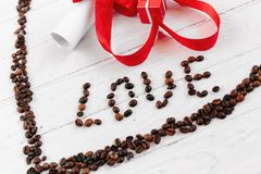L'inscription de l'amour des grains de café Images stock