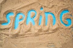 L'inscription le ressort de sable Photo stock