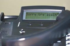 L'inscription sur l'affichage du ` désolé d'essai de ` de téléphone de fil de bureau encore images stock