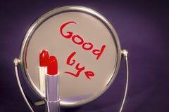 L'inscription sur le miroir écrit dans le rouge à lèvres Photographie stock libre de droits