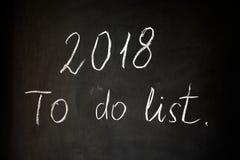 L'inscription sur le panneau de craie noir : 2018 pour faire la liste images stock