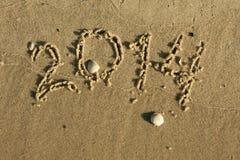 L'inscription sur le sable 2014 Photos stock