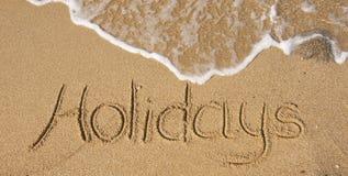 L'inscription sur le sable - vacances Image stock