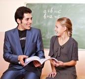 L'insegnante e la scolara si divertono Fotografie Stock Libere da Diritti