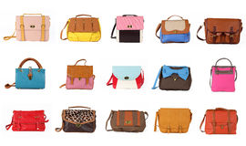 L'insieme dei sacchetti femminili multicolori su un background 15 pezzi Fotografia Stock