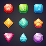 L'insieme del fumetto ha colorato le pietre con l'elemento differente dei segni per uso nel gioco, tre in una fila Fotografia Stock