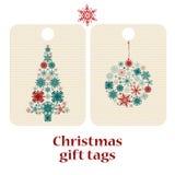 L'insieme del Natale e dei nuovi anni di regalo etichetta con i fiocchi di neve Fotografie Stock