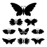 L'insieme del nero astratto profila i butterflys Immagine Stock Libera da Diritti