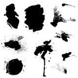 L'insieme del nero macchia e l'inchiostro spruzza isolato su fondo bianco Fotografie Stock