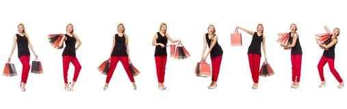 L'insieme della donna con i sacchetti della spesa su bianco Fotografia Stock